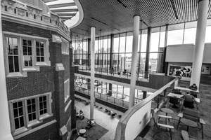 Black and white photo showing the exterior of ARH within the atrium of the HSSC