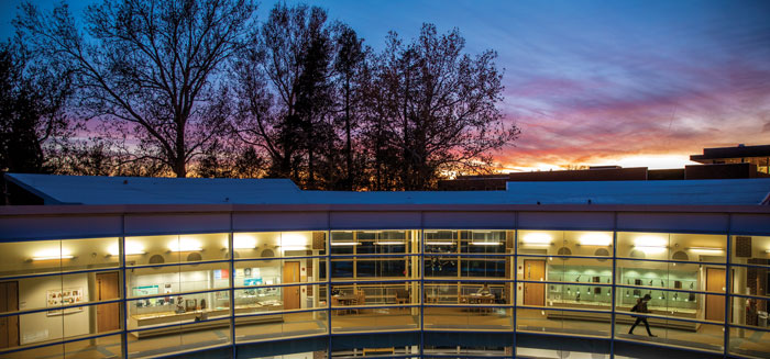 The Noyce Sience Center elbow light up at sunset