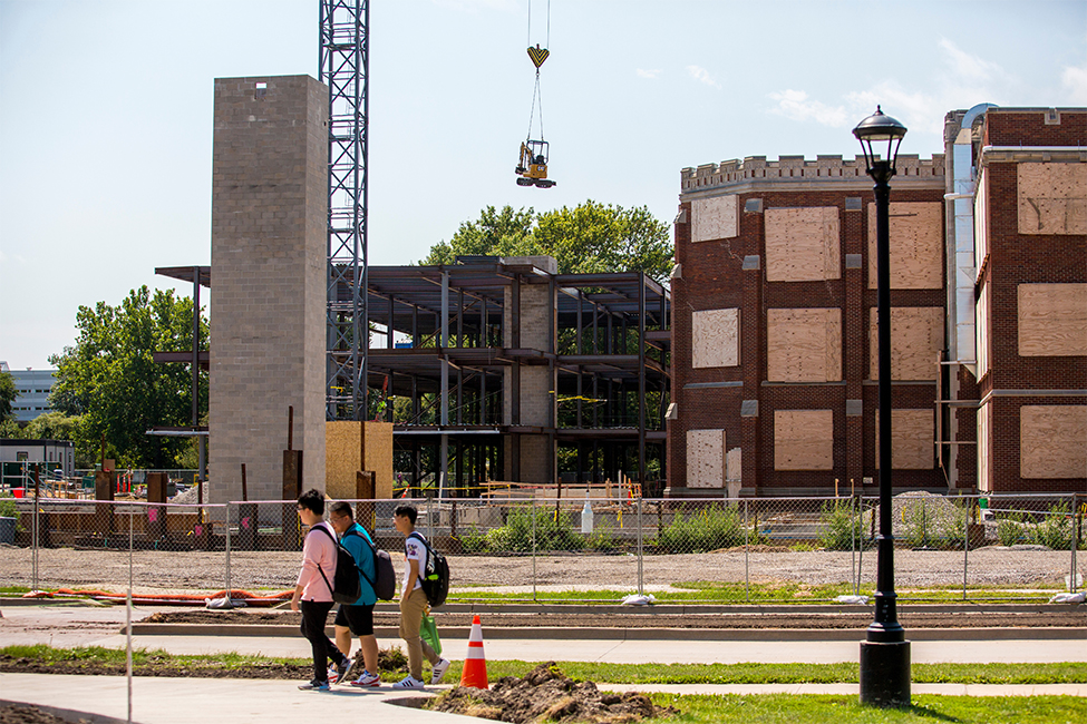 Construction site of Humanities and Social Studies Complex, boarded up windows on ARH, steel beam structure in place