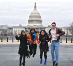 People jump with U.S. Capitol in the background