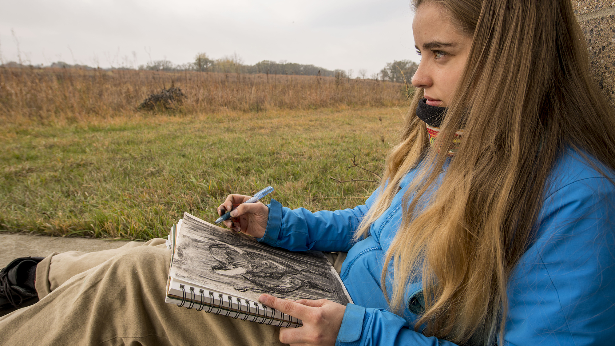 Students in Lee Running, Associate Professor of Art, drawing class use observational drawing techniques during a trip to the Conrad Evironmental Research Area