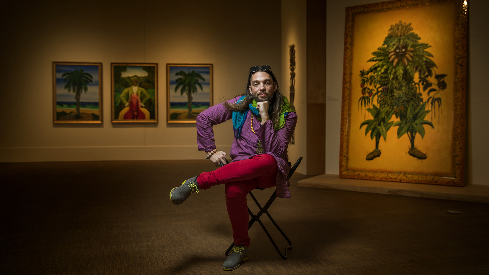 Fredo Rivera '06 sitting on a chair in the Faulconer Art Gallery