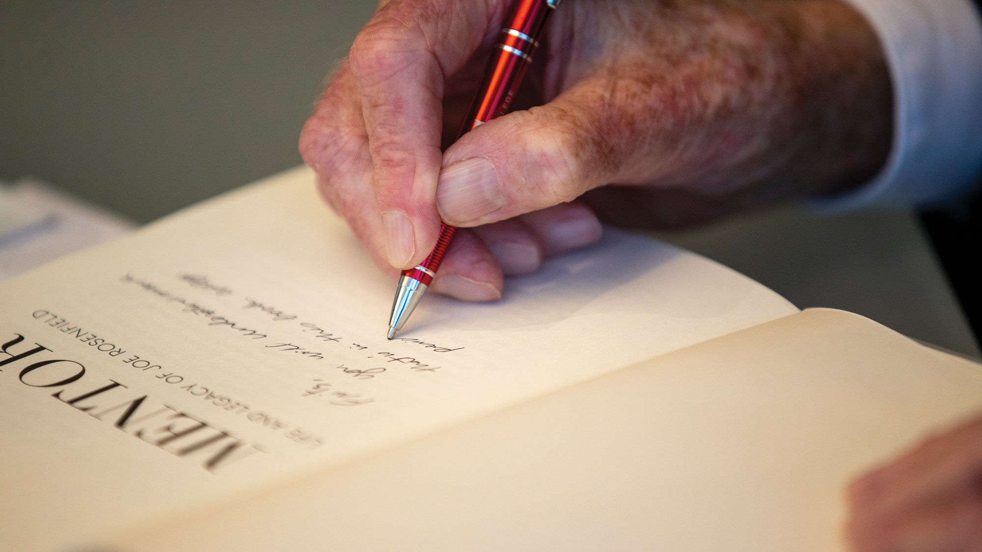 Author signing copy of Mentor
