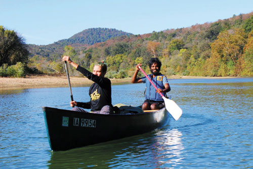 Two paddlers in a shared canoe