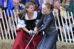 Two women sword fighting