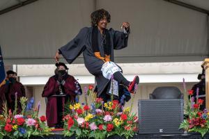 Commencement Speaker Kesho Scott kicking up a leg