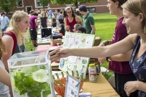Real Foods Coordinator Molly Schintler encourages students to sample real foods.