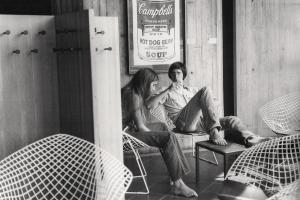 students lounging is Forum chairs beneath a Campbells Soup poster