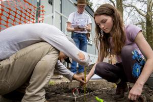 Students work to excavate Peace Rock