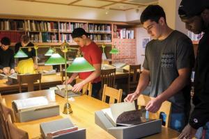 Students explore books in the Rare Books Room